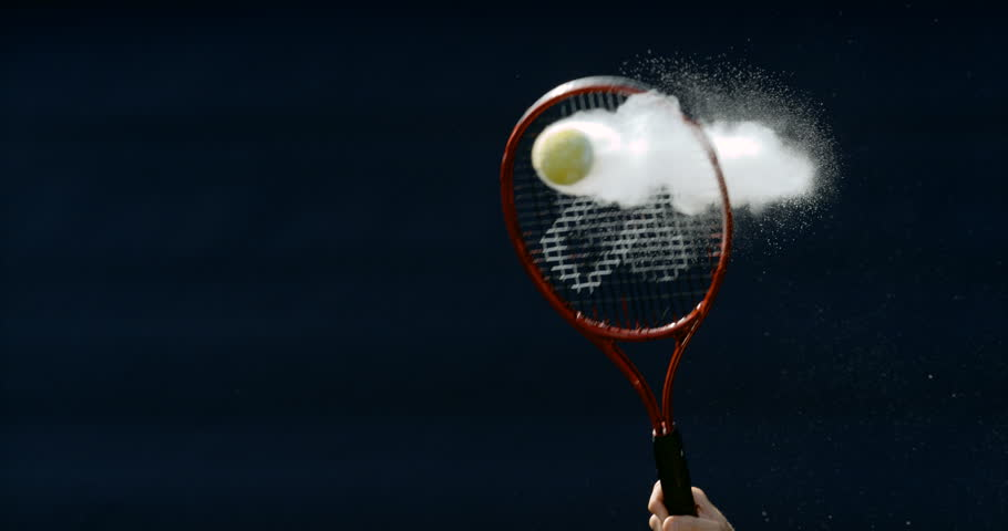 4K Close up in super slowmo, tennis ball suspended in mid air before being hit Dec 2016-UK