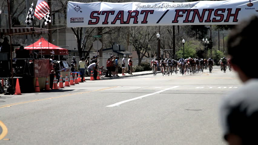 California - Circa 2009: A bike race in 2009. The winner crossing finish line in California.