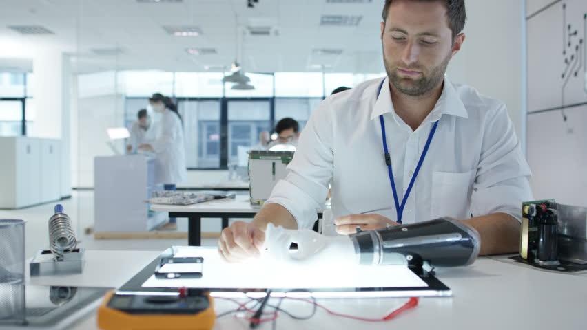 4K Electronics engineering team building & testing robotics & electronics Dec 2016-UK Royalty-Free Stock Footage #22963648