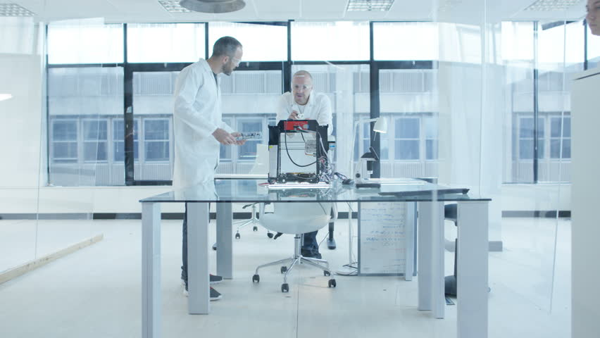 4K Electronics engineering team building & testing robotics & electronics Dec 2016-UK   Shutterstock HD Video #22963666