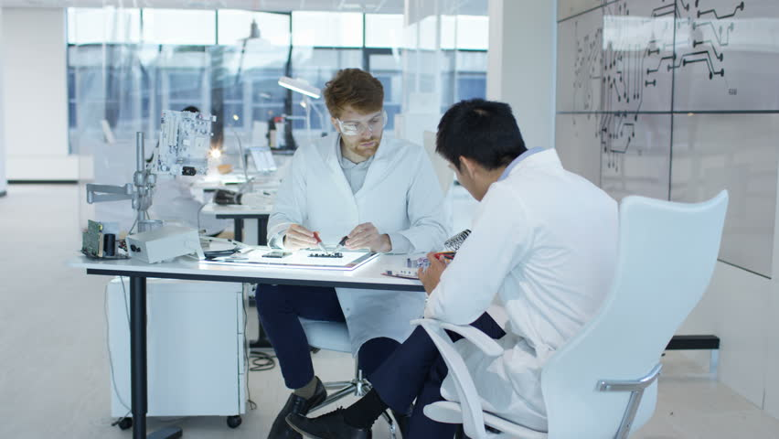 4K Electronics engineers working in lab building & testing electronic devices Dec 2016-UK | Shutterstock HD Video #22966294