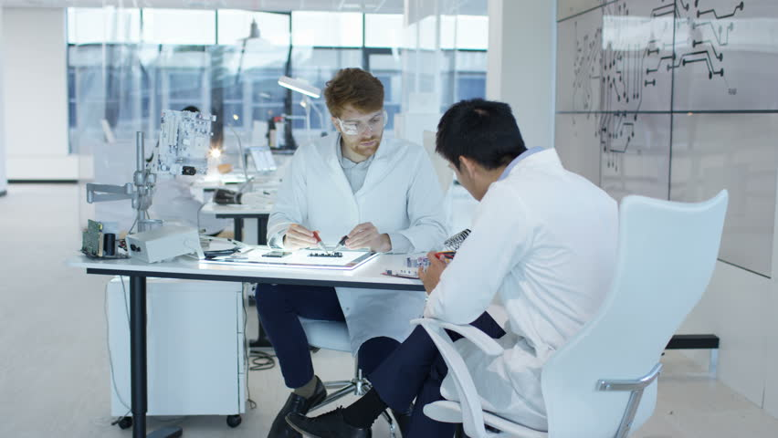 4K Electronics engineers working in lab building & testing electronic devices Dec 2016-UK | Shutterstock HD Video #22966336