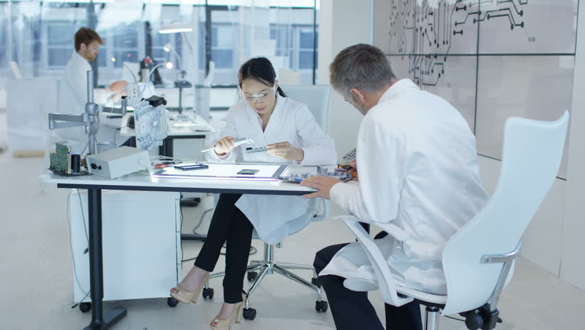 4K Electronics engineers working in lab building & testing electronic devices Dec 2016-UK | Shutterstock HD Video #22966411