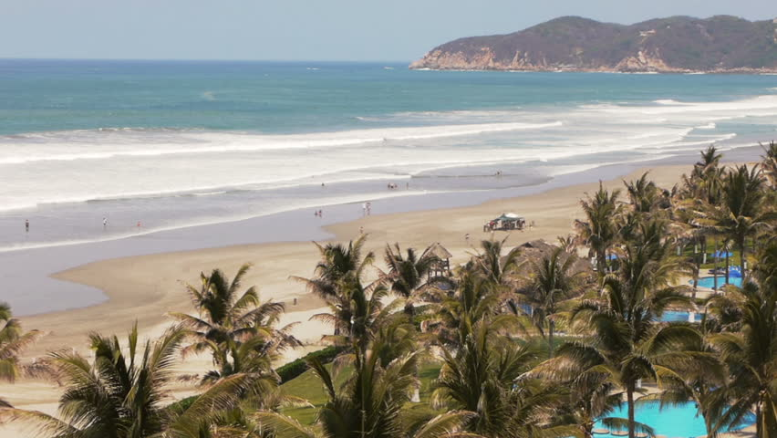 Multitude of waves hit the Mexican Pacific coastline near Acapulco bay Mexico. This is the view of the beach of Acapulco Diamante which is the new developed part of the region.