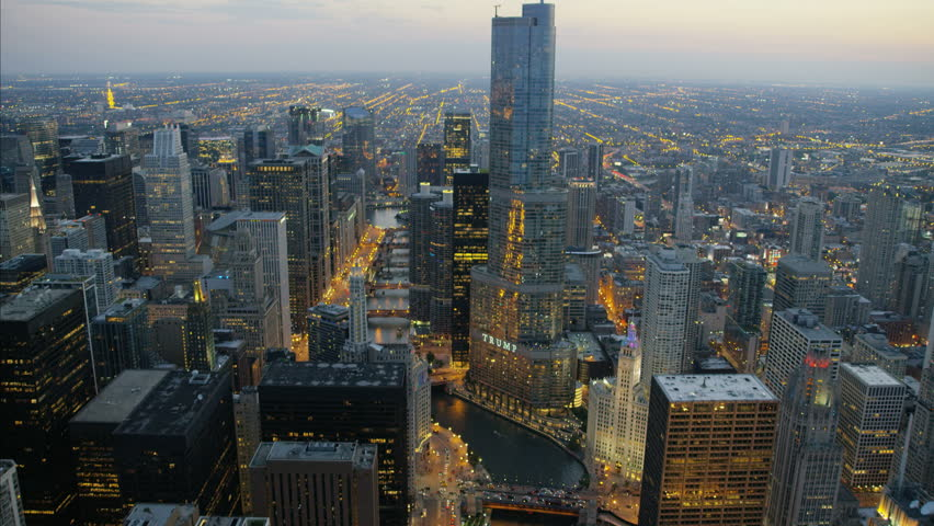 Chicago, USA - September 2016: Aerial sunset illuminated view of Trump Tower Chicago River Illinois Metropolitan skyline Skyscraper buildings in Downtown Business and Financial District USA aa | Shutterstock HD Video #22985338