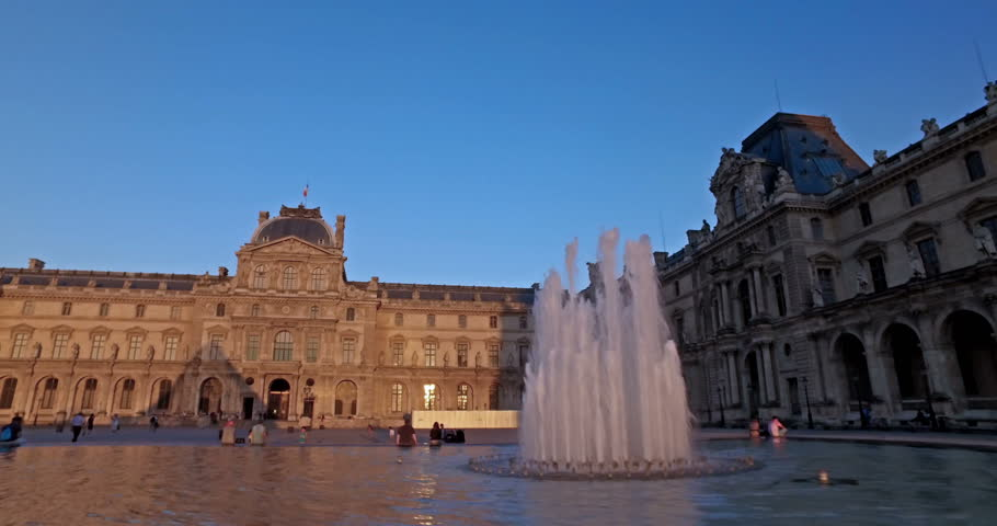 Paris, France. Circa August 2016. Tourists outside Louvre museum at sunset. Dolly camera movement.   Shutterstock HD Video #23005546