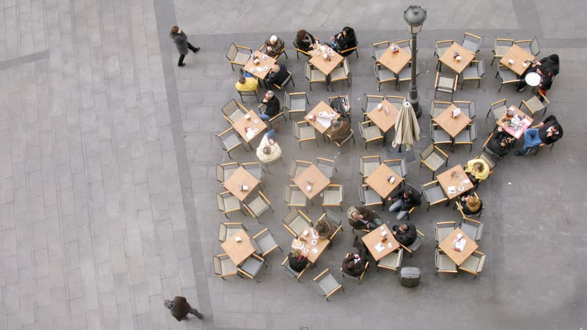 MADRID - CIRCA MARCH 2012: (Timelapse View) People sit at cafe with little tables on street in Madrid circa March 2012.  | Shutterstock HD Video #2300822