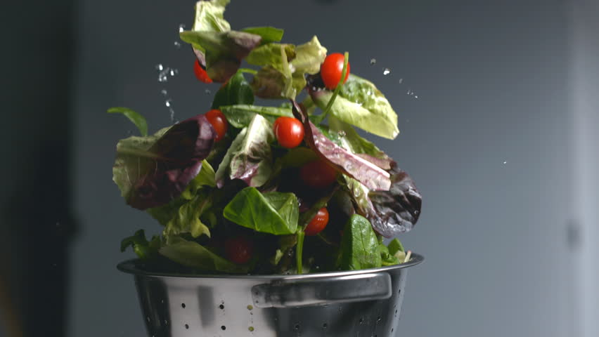 Salad flying out of colander in super slow motion, shot on Phantom Flex 4K