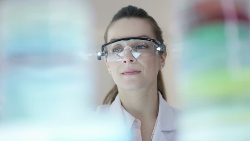 4K Close up portrait smiling chemical research scientist working in the lab Dec 2016-UK | Shutterstock HD Video #23021941