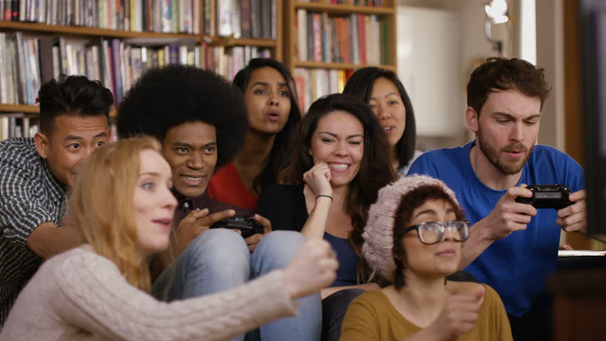 4K Large group of happy young friends playing video games at home Dec 2016-UK   Shutterstock HD Video #23024329
