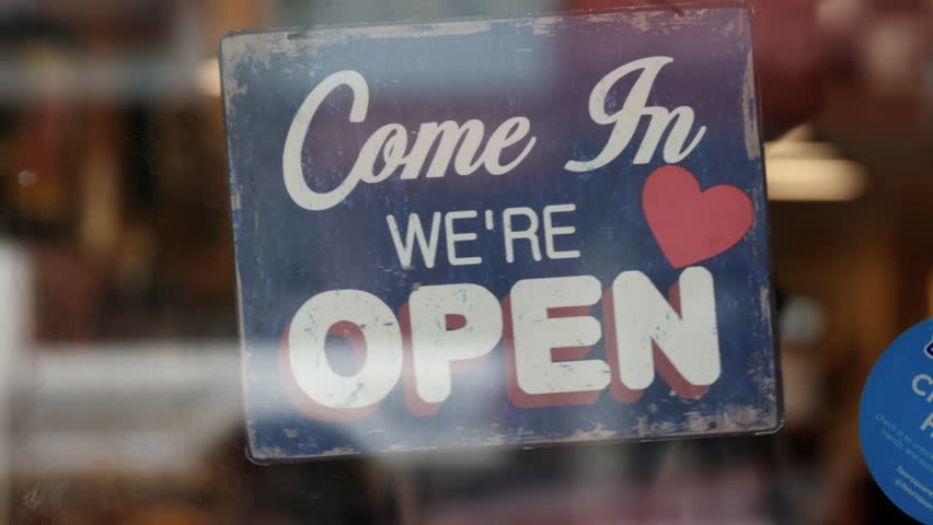 Open sign on window of coffee shop