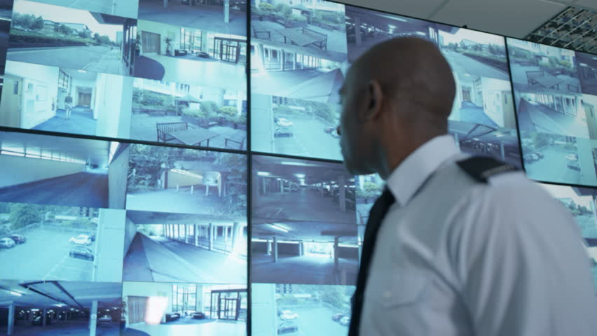 4K Portrait smiling security officers in system control room Dec 2016-UK