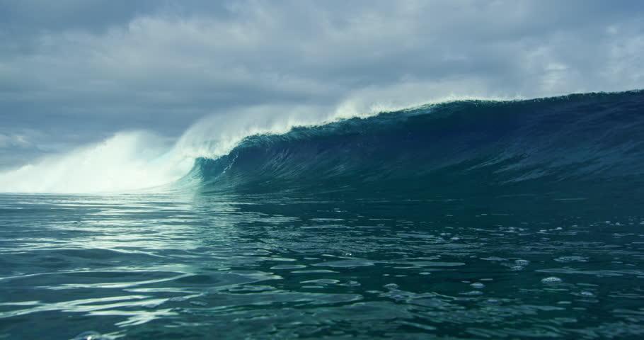 Beautiful blue ocean wave breaking in slow motion 4K