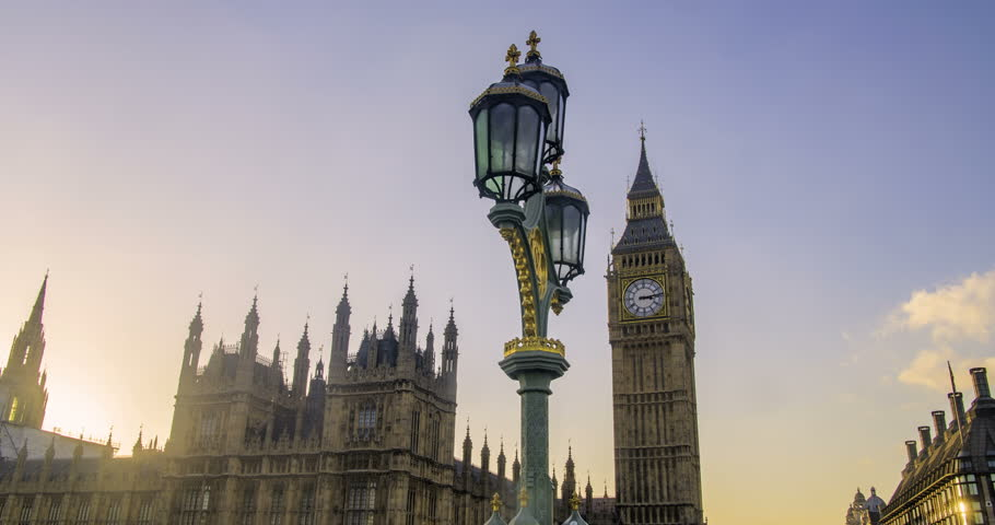 Time lapse dolly view of the House of Parliament and the Big Ben in London before sunset