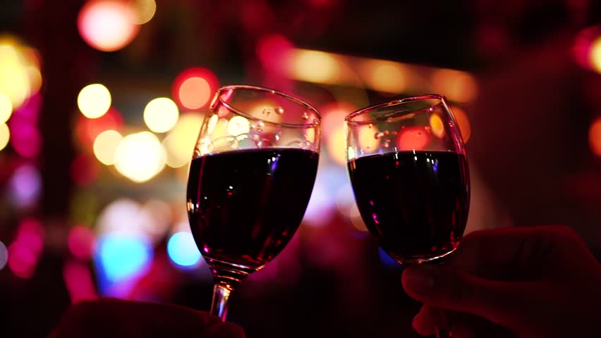 Two People Cheers or Toast Red Wine Glasses Clinking. Holiday Celebration Concept. | Shutterstock HD Video #23044495