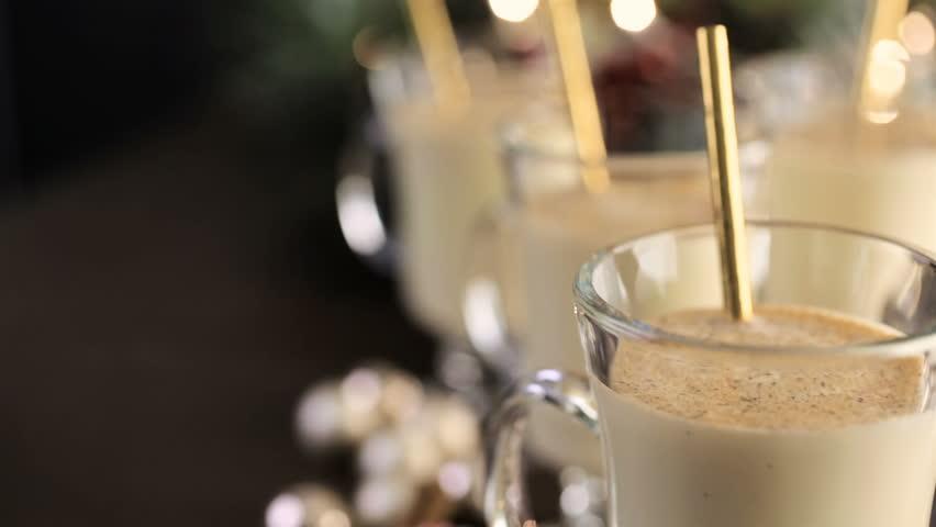 Traditional holiday drink egg nog garnished with nutmeg. | Shutterstock HD Video #23060533