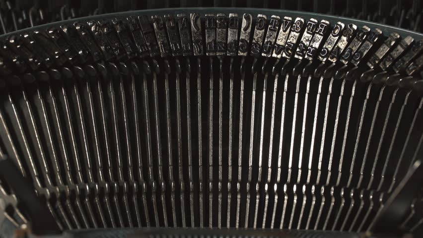 Detail of an old typewriter, machine of the 30s. The light from the darkness goes to the detail of typewriter   Shutterstock HD Video #23075719