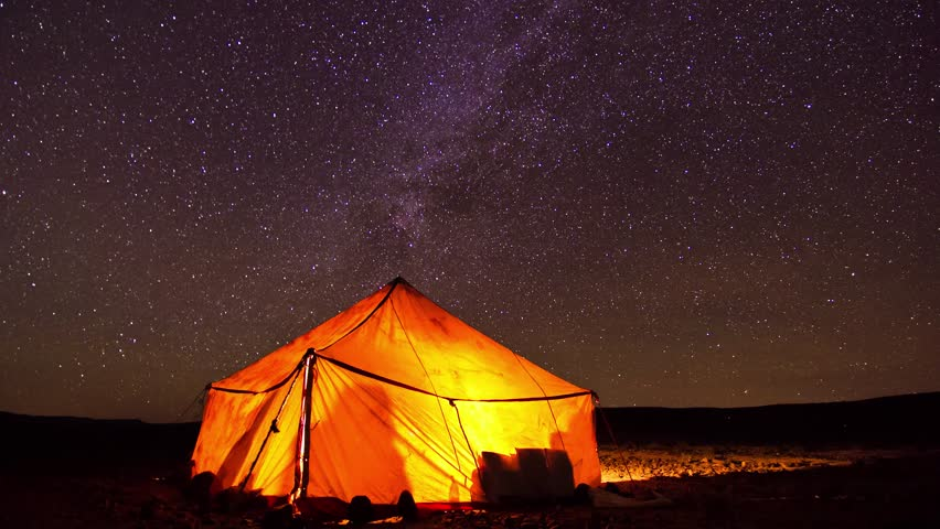 4k timelapse of the Milky Way passing over a Haima, a nomadic tent, in the Sahara desert, near the dunes of Erg Chegaga, in Morocco.
