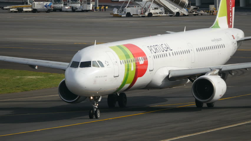 Airliner Taxiing Closeup. Airbus A321 of TAP Portugal at Madeira LPMA Airport. 4K Ultra HD Wide Body Passenger Airplane Spotting. Madeira Airport (Funchal, FNC, LPMA) Portugal 27 Nov. 2014.