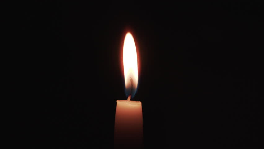 tall candle blown in the dark environment, uhd prores footage #23082382