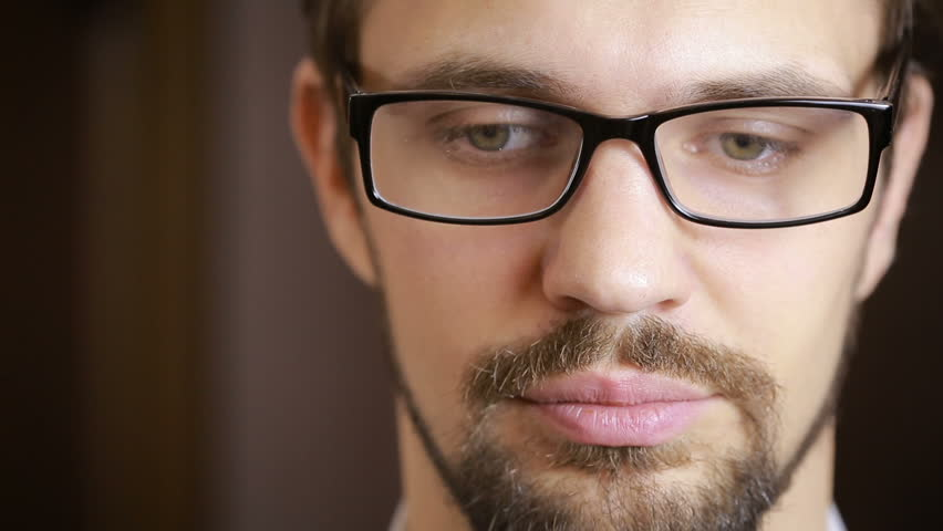 Handsome fashion model man portrait with green eyes and smile close up. beard | Shutterstock HD Video #23086459