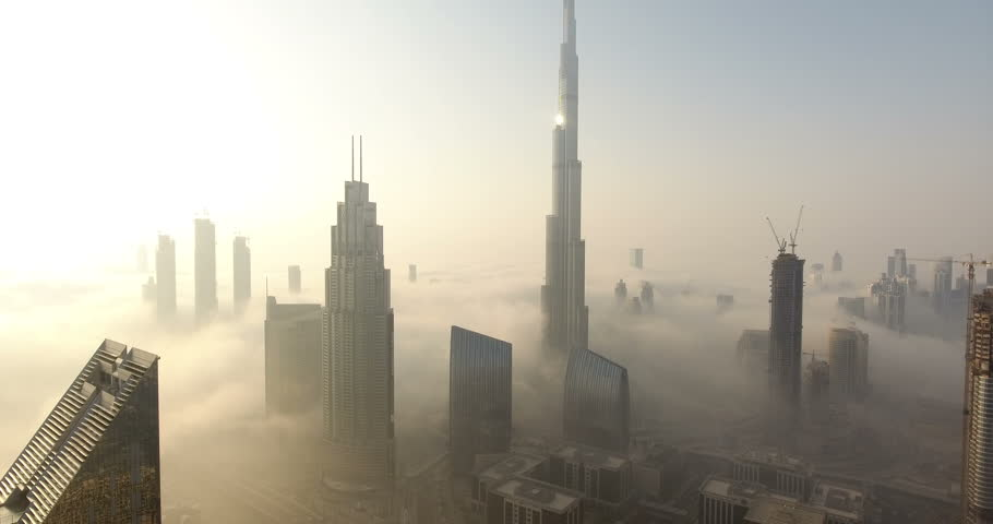 DUBAI, UAE - JANUARY 2, 2017: Aerial view of Burj Khalifa downtown Dubai at sunrise. The Burj al Khalifa is the tallest structure in the world, standing at 829.8 m (2,722 ft). Scenic foggy weather.
