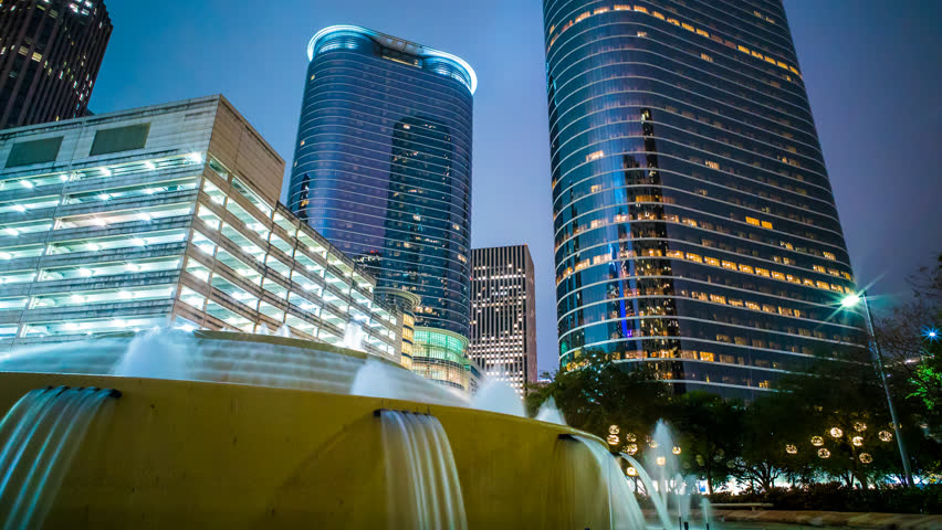 Houston Skyline time lapse at night 4K 1080p with buildings and water fountain