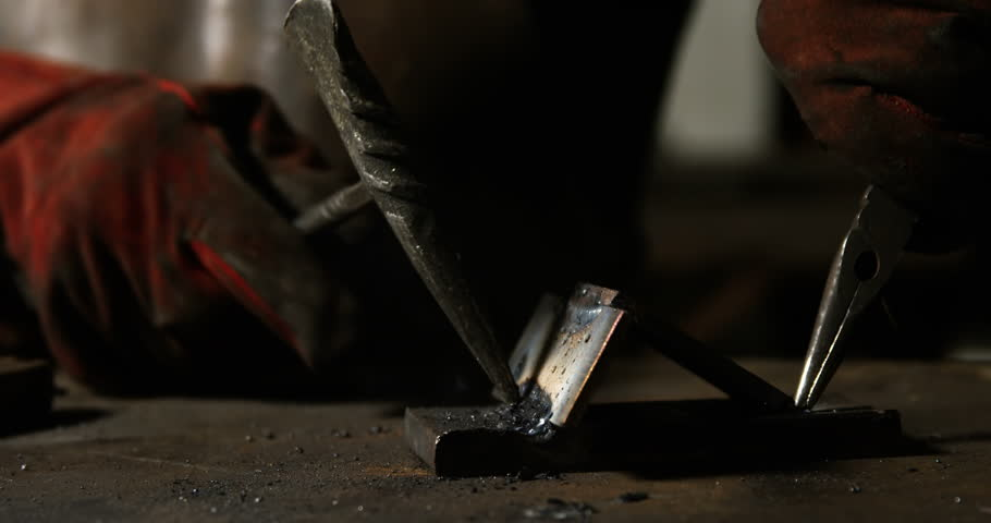 Hands of welder working on a piece of metal in workshop   Shutterstock HD Video #23130130