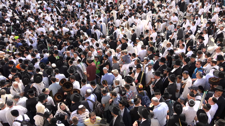 JERUSALEM, ISRAEL - 19 OCTOBER 2016: Overhead view of massive crowds of Jewish male worshipers (mostly wearing traditional dress) visiting the Western Wall during Sukkot in Jerusalem #23135773