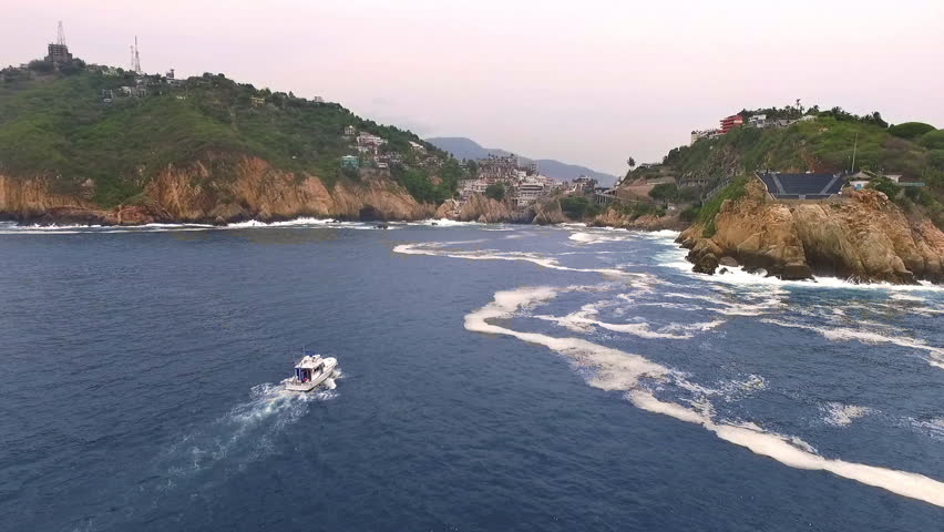 Aerial shot of a yacht in La Quebrada Acapulco, Guerreo Mexico