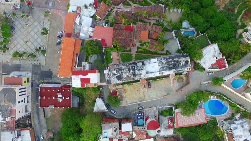 Aerial shot of La Quebrada, paradaise in Acapulco Guerrero Mexico and some houses and hotels
