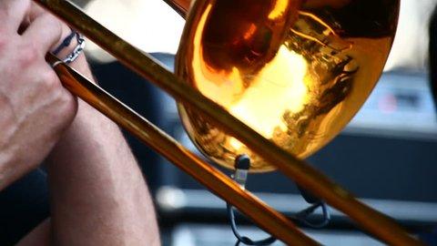 A man playing on trombone
