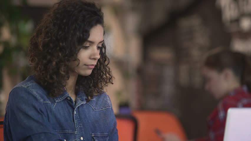 Beautiful mixed race woman making video call on laptop, modern technologies | Shutterstock HD Video #23158690