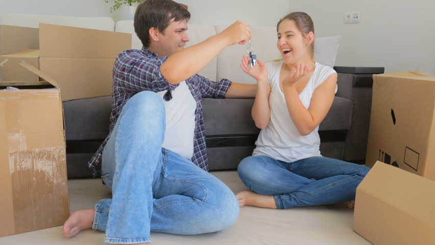 Happy young woman rejoicing of keys from new apartment husband gave her #23159842