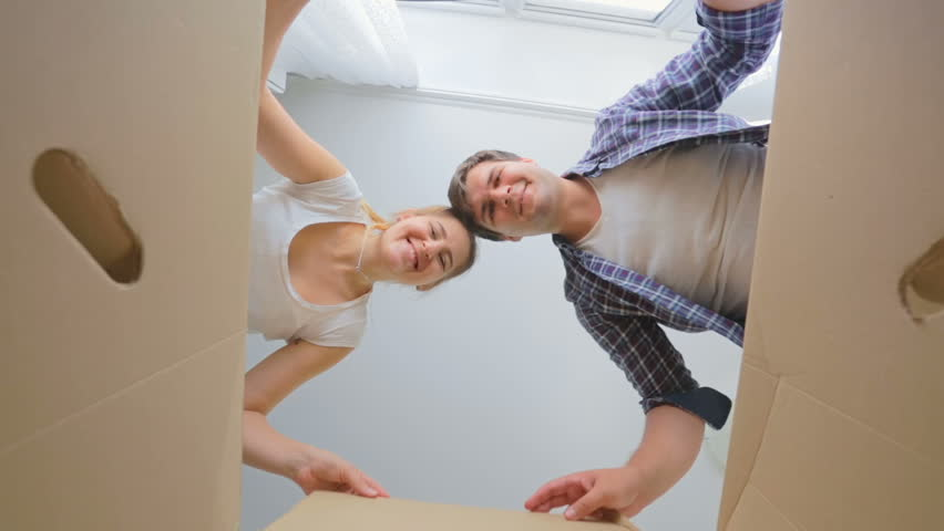 POV of happy young couple opening big cardboard box #23159971