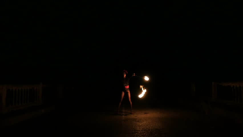 The fire dance show at a party held by the sea. women and men play fire show dance party held at the seaside dinner. | Shutterstock HD Video #23172115