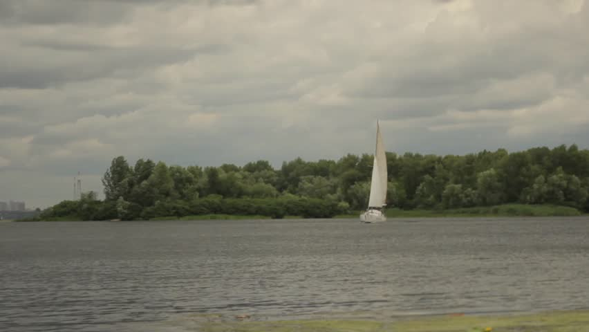 KYIV, UKRAINE - AUGUST 1, 2015. Yacht with white sail floating on the water. | Shutterstock HD Video #23174038