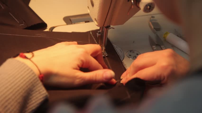 Seamstress sewing cloth sewing machine (rear view) | Shutterstock HD Video #23175103