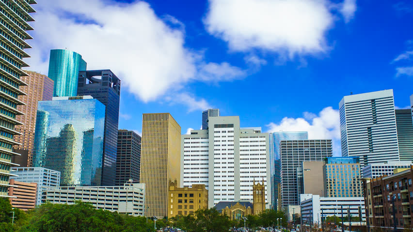Houston Texas Skyline Clouds Time Lapse 4K 1080p. A time-lapse of Houston cityscape with clouds rolling over buildings and blue skies