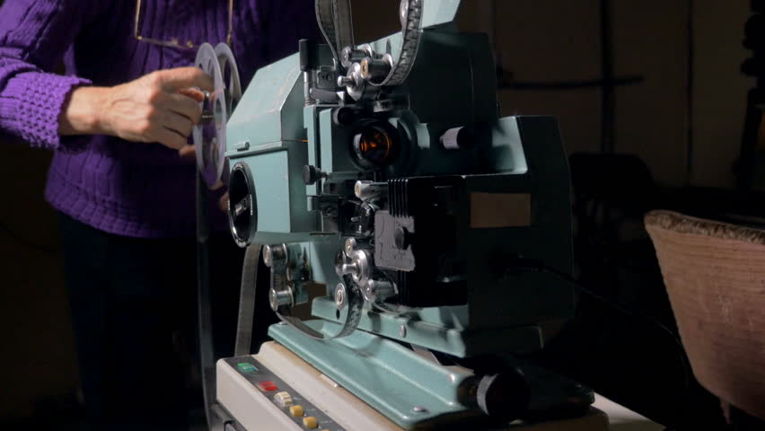 Film projector. Cameraman setting old movie projector. | Shutterstock HD Video #23179354