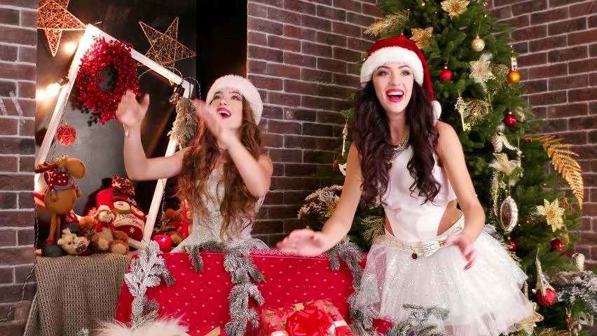 Gifts are flying, girl assistant of Santa Claus catch flying Christmas gifts, many surprises, gifts are falling from ceiling, Christmas miracle, catch Christmas offer | Shutterstock HD Video #23183962
