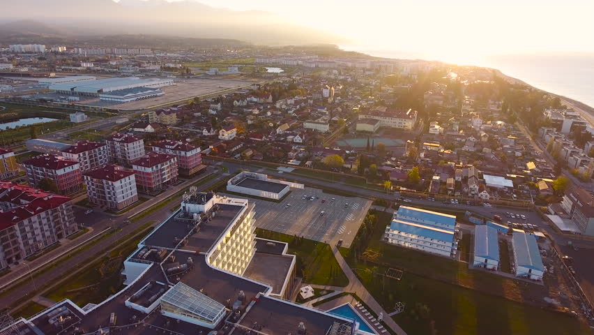 Aerial View. Flying over the city buildings houses  sea near the beach on a sunny day. Sochi Adler olympiad. Aerial drone shot. 4K 30fps ProRes (HQ) | Shutterstock HD Video #23192356