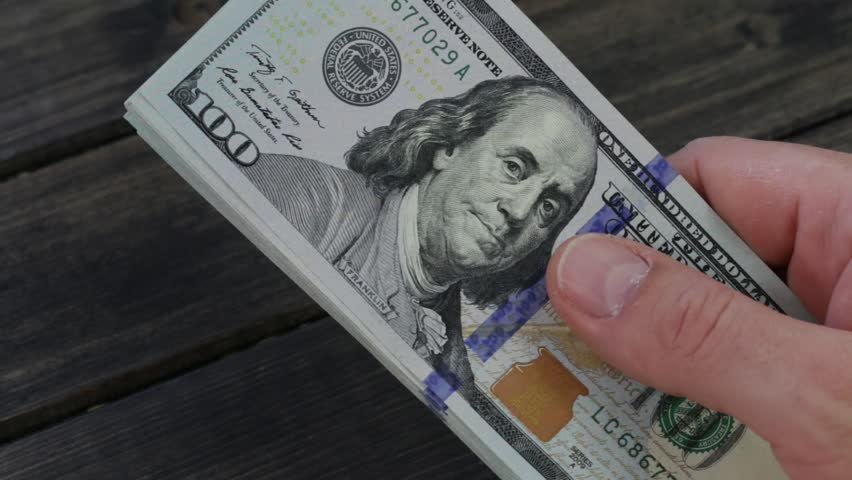 Counting american paper money close-up. Man hands counting a lot of one hundred dollar bills   Shutterstock HD Video #23193268