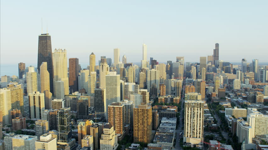 Aerial sunlight sunset view of Hancock Center Chicago Illinois Metropolitan Technology city skyline Skyscraper buildings Downtown Business District USA RED DRAGON | Shutterstock HD Video #23197906