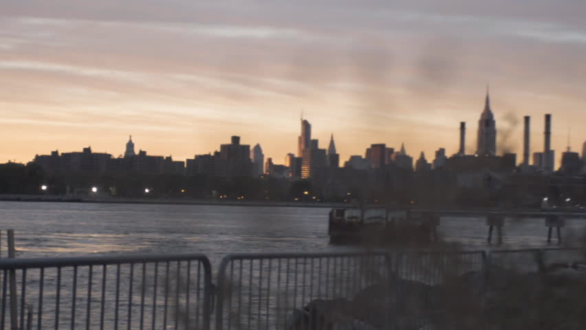 An establishing shot of New York City's Empire State Building. Shot from across The East River in Williamsburg Brooklyn. Shot during the summer of 2016. | Shutterstock HD Video #23201278