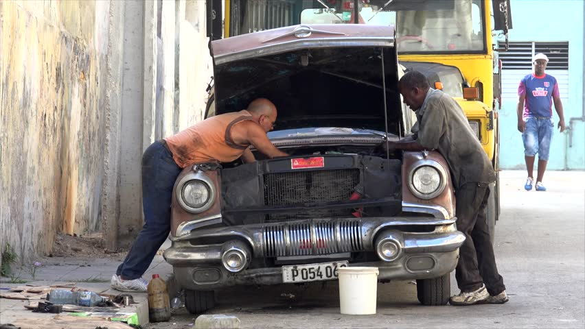 CUBA, - NOVEMBER 20: Repair works with the engine of an old american car.  November 20, 2016 in Havana, Cuba
