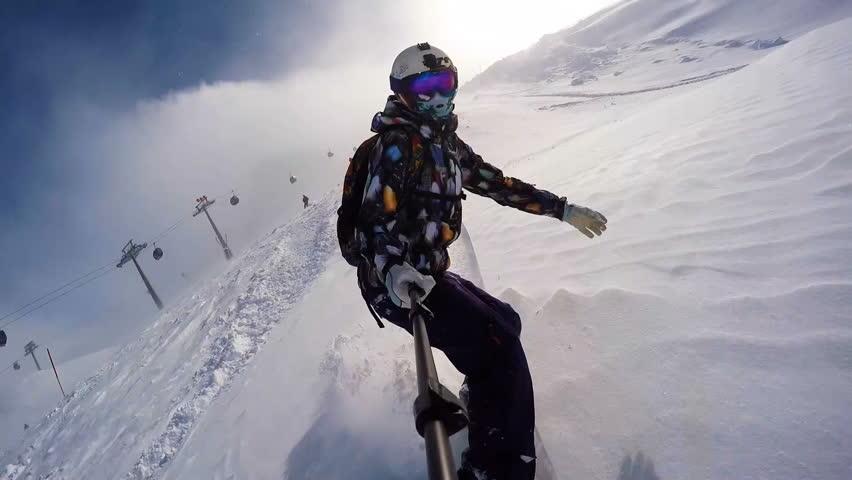 Snowboarding girl in powder in Alps wearing helmet #23211181
