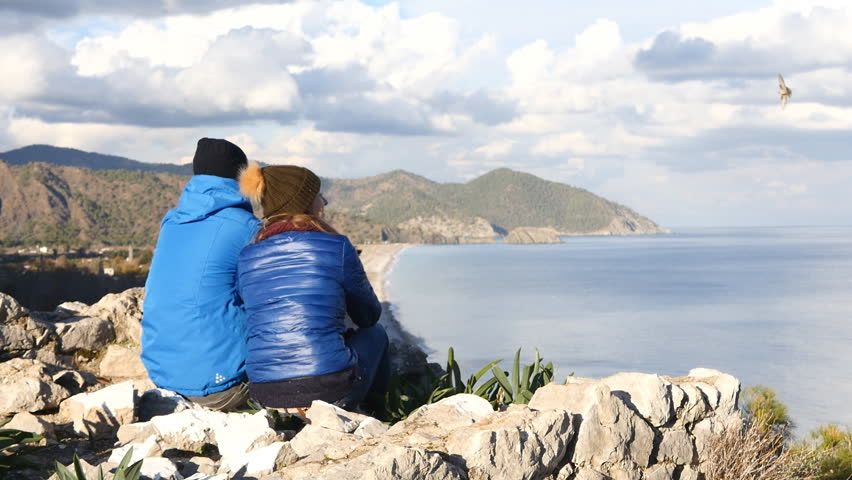 Young couple sitting on the top of the rock | Shutterstock HD Video #23222851