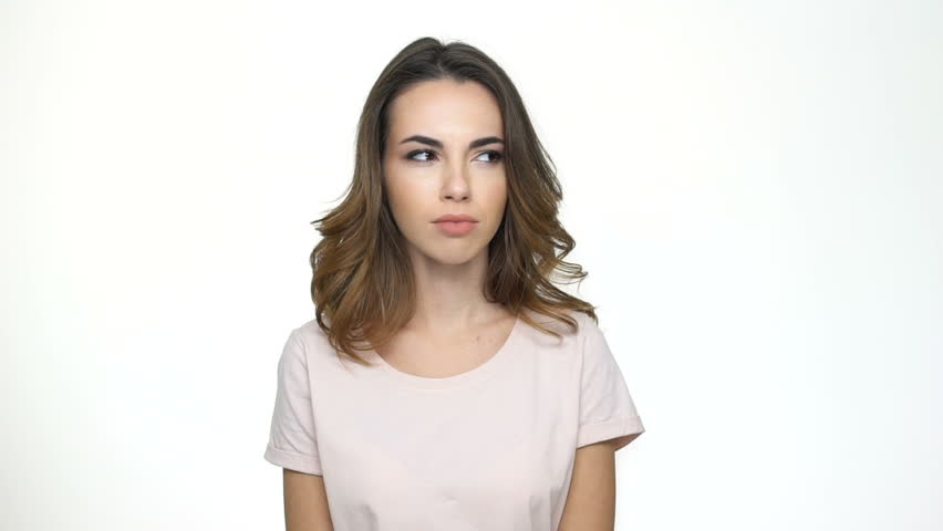 Young unhappy woman covering her nose with hand and waving over white background | Shutterstock HD Video #23223352