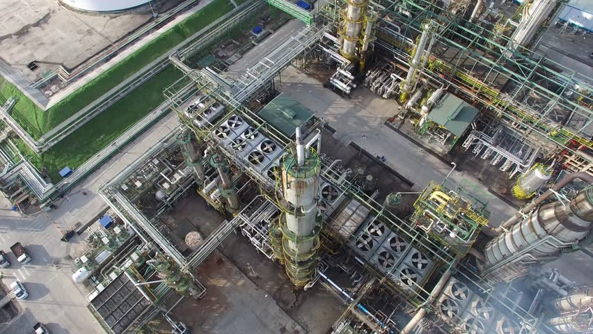 Oil Gas Refinery Aerial 4K, Aerial top down view over oil refinery or chemical factory and power plant with many storage tanks and pipelines